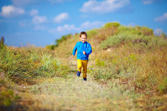 Happy kid running the summer field Stock Photography