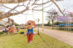 Happy kid sculpture. Enjoy swing royalty free illustration