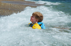 Happy kid in the sea water Stock Photo