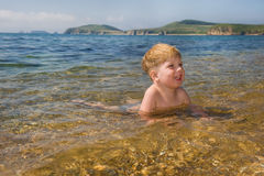 Happy kid in the sea water Royalty Free Stock Images