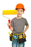 Happy kid showing paint roller Royalty Free Stock Photo