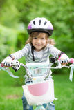 Happy kid sitting on the bike Stock Photo