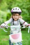 Happy kid sitting on the bike Stock Photo