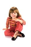 Happy kid sitting on the floor Royalty Free Stock Photo