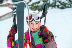Happy kid with skis Stock Images