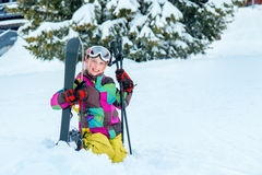 Happy kid with skis Royalty Free Stock Photos
