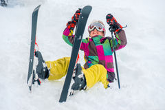 Happy kid with skis Royalty Free Stock Photo