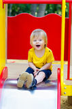 Happy kid on the slide Royalty Free Stock Images