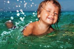 Happy kid splashing in the sea Royalty Free Stock Photography