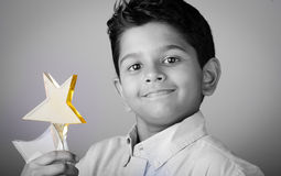 Happy kid or student with  award. Royalty Free Stock Image
