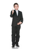 Happy kid in suit holding thumb up Stock Images