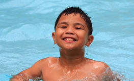 Happy kid swimming Royalty Free Stock Photo