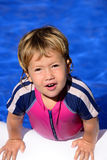 Happy kid in the swimming pool Royalty Free Stock Images