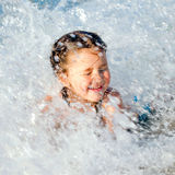 Happy kid swimming in the in sea foam Stock Images