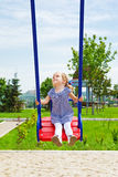 Happy kid on a swing Royalty Free Stock Photos