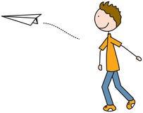 Happy kid throwing paper plane Royalty Free Stock Photos
