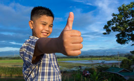 Happy kid with thumbs-up gesture from Philippines Royalty Free Stock Photos