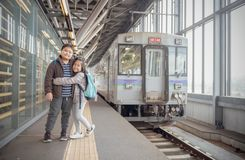 Happy kid traveler with old japan train royalty free stock photos
