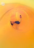 Happy kid in a tube slide Royalty Free Stock Photography