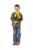 Happy kid with tulips. Sweet kid with a bouquet of tulips smiling happily Royalty Free Stock Photos
