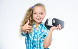 Happy kid use modern technology. Little child in VR headset. Little girl wearing virtual reality goggles. Digital future royalty free stock photography
