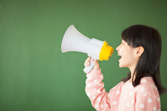 Happy kid using a megaphone to shout Royalty Free Stock Photo