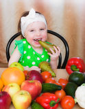 Happy Kid with vegetables and fruits. Stock Image