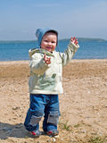 Happy kid walking on the beach Stock Images