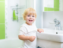 Happy kid washing hands in bathroom Royalty Free Stock Photos