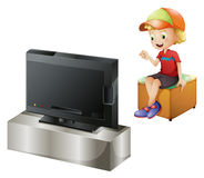 A happy kid watching TV. Illustration of a happy kid watching TV on a white background Royalty Free Stock Image