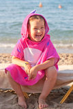 Happy kid wearing beach towel Royalty Free Stock Photography