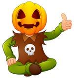 Happy kid wearing pumpkin mask giving thumb up Royalty Free Stock Photography