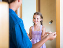 Happy kid welcoming friend Royalty Free Stock Photography