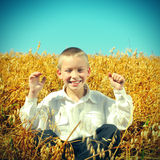 Happy Kid at Wheat Field Royalty Free Stock Images