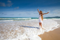 Happy kid in white dress on sea beach Royalty Free Stock Photos