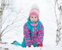 Happy kid winter day. Stock Photos