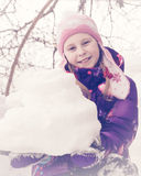 Happy kid winter day playing in the snow. Stock Photography