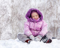 Happy kid in winter park Royalty Free Stock Photography