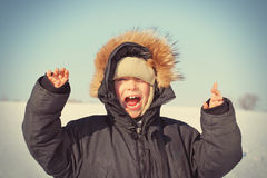 Happy Kid in the Winter Stock Images