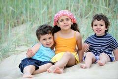 Happy kids. Three happy kids on the beach Royalty Free Stock Photography