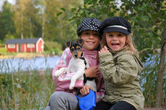 Happy kids. Portrait of happy kids with dog Royalty Free Stock Photo
