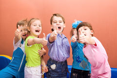 Happy kids. Group of happy kids showing their thumbs up Royalty Free Stock Photography