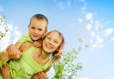 Happy Kids. Sister and Brother outdoor. Family royalty free stock photo