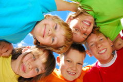 Happy kids. Forming a huddle royalty free stock photography