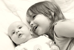 Happy Kids. Small girl playing with her baby brother Stock Photos