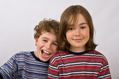 Happy kids. Portrait of two young happy kids royalty free stock photos