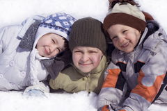 Happy kids. Sister and brothers on snow Royalty Free Stock Photography