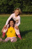 Happy kids. Outdoor portrait of two little female kids with a happy smiling in her face Royalty Free Stock Photo