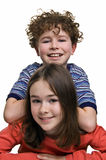 Happy kids. Portrait of two young happy kids isolated on white background royalty free stock photo