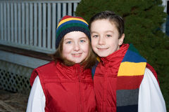 Happy Kids. Adorable brother and sister in matching scarf and hat Royalty Free Stock Photos